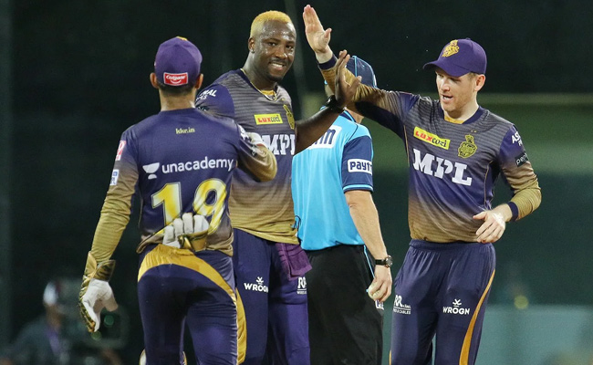 Andre Russell celebrates the wicket of Jasprit Bumrah