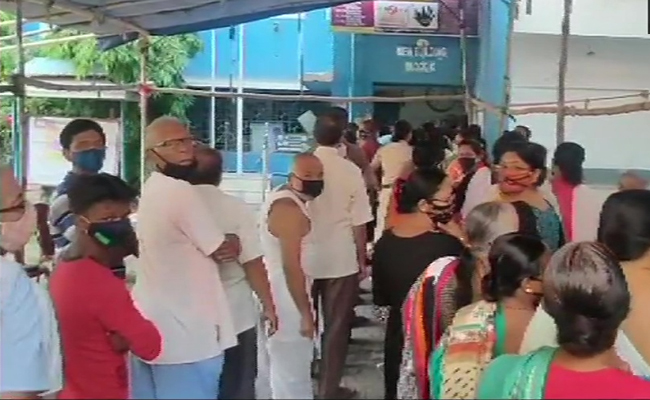 Voters queue outside polling booth