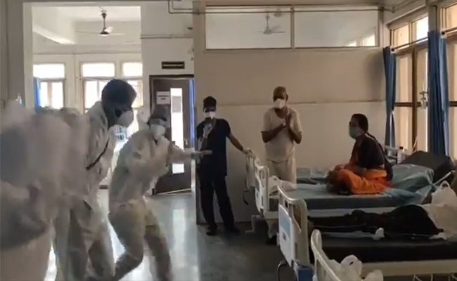 Doctors dance in front of covid patients